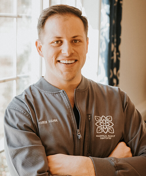Our dentist in Lucedale, MS, Dr. Christopher A. Hamm smiling with his arms crossed