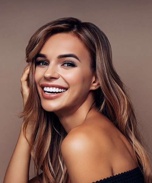 A beautiful woman smiling with perfect teeth